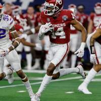 Oklahoma wide receiver Charleston Rambo (14) returns Florida punt in the first half of the Cotton Bowl NCAA college football game in Arlington, Texas, Wednesday, Dec. 30, 2020. (AP Photo/Michael Ainsworth)