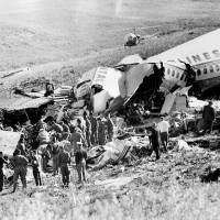 Photo -   FILE - This May 23, 1962 file photo shows officials searching the wreckage of Continental Airlines Flight 11 which crashed near Unionville, Mo. Aviation buffs know Flight 11 as the country's first bombing of a commercial jet airliner, an act of sabotage by a passenger that killed all 45 people on board. Yet the crash of the plane, which departed Chicago en route to Los Angeles with a Kansas City stop, was largely forgotten as time passed, families moved on and more horrific airline incidents came to dominate history. (AP Photo/Kansas City Star, File)
