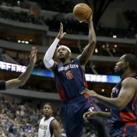 Photo - Detroit Pistons forward Josh Smith (6) finds an opening to the basket against Dallas Mavericks' Brandan Wright (34) in the first half of an NBA basketball game, Sunday, Jan. 26, 2014, in Dallas. (AP Photo/Tony Gutierrez)