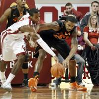 Photo - Sooner's Buddy Hield, left, and Cowboy's Michael Cobbins fight for a ball under the basket as the University of Oklahoma Sooners (OU) play the Oklahoma State Cowboys (OSU) in NCAA, men's college basketball at The Lloyd Noble Center on Saturday, Jan. 12, 2013  in Norman, Okla. Photo by Steve Sisney, The Oklahoman