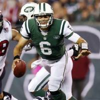 Photo -   Houston Texans defensive end J.J. Watt (99) tackles New York Jets quarterback Mark Sanchez (6) during the second half of an NFL football game, Monday, Oct. 8, 2012, in East Rutherford, N.J. The Texans won 23-17. (AP Photo/Julio Cortez)