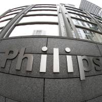 Photo - Exterior view of the headquarters of Philips in Amsterdam, Netherlands, Tuesday Jan. 29, 2013. Royal Philips Electronics NV Tuesday said it will sell the entertainment division which contains many of the consumer products for which it is best known, such as audio and video equipment, to Funai Electric Co., Ltd., of Japan for Euros 150 million (USD 202 million) plus licensing fees. Funai will assume responsibility for the manufacturing of the Philips products but license and sell them under the Philips brand for five years. It has an option to renew. (AP Photo/Peter Dejong)