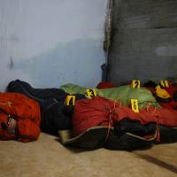 Photo -   Bodies of climbers killed in an avalanche at Mount Manaslu lie covered with numbers at the Tribhuvan University Teaching hospital in Katmandu, Nepal, Monday, Sept. 24, 2012. Rescue helicopters flew over the high slopes of a northern Nepal peak again Monday to search for climbers lost in an avalanche that killed at least nine mountaineers and injured others. Many of the climbers were French, German and Italian. (AP Photo/Niranjan Shrestha)