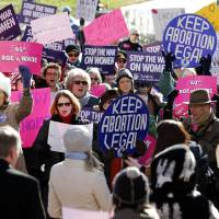 Photo - Abortion rights advocates shout during a rally in Capitol Square in Richmond, Va., Tuesday, Jan. 22, 2013, marking the 40th anniversary Tuesday of the landmark U.S. Supreme Court ruling on abortion known as Roe v. Wade. (AP Photo/Richmond Times-Dispatch, Bob Brown)