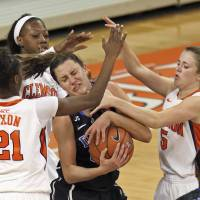 Photo - Duke's Haley Peters, center, is trapped between Clemson's Nikki Dixon (21), Kelly Gramlich, right, and Quinyotta Pettaway during the second half of an NCAA college basketball game Thursday, Feb. 6, 2014, in Clemson, S.C. (AP Photo/Anderson Independent-Mail, Mark Crammer) SENECA OUT  GREENVILLE OUT