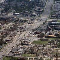 Photo - This aerial photo shows the devastation of  the Cedar Crest and Forest Lake neighborhoods in Tuscaloosa, Ala. on  Thursday, April 28, 2011. A powerful and deadly tornado cut through Tuscaloosa Wednesday evening.  President Barack Obama said he would visit Alabama Friday to view damage and meet with the governor and families devastated by the storms.  Obama has already expressed condolences by phone to Gov. Robert Bentley and approved his request for emergency federal assistance. (AP Photo/The Tuscaloosa News, Dusty Compton)