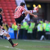 Photo - Sheffield United's Ryan Flynn scores their first goal of the game against Charlton Athletic during the FA Cup Sixth Round match at Bramall Lane, Sheffield, England, Sunday March 9, 2014. (AP Photo/Nick Potts, PA) UNITED KINGDOM OUT - NO SALES - NO ARCHIVES