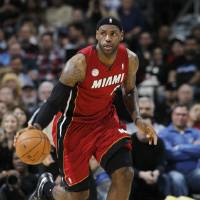 Photo -   Miami Heat forward LeBron James picks up a loose ball against the Denver Nuggets in the first quarter of an NBA basketball game in Denver on Thursday, Nov. 15, 2012. (AP Photo/David Zalubowski)