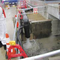 Photo - In this photo provided by Tokyo Electric Power Co. (TEPCO), underground water is being released into the ocean through a piping at Fukushima Dai-ichi nuclear plant in Okuma, Fukushima prefecture, northern Japan Wednesday, May 21, 2014. Japan's crippled nuclear power plant has begun releasing groundwater from the least contaminated areas of the facility into the ocean so it does not run into contaminated areas and create more toxic water amid storage space limitations. (AP Photo/Tokyo Electric Power Co. )