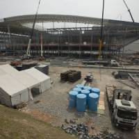 Photo - Construction continues at the Itaquerao stadium in Sao Paulo, Brazil, Wednesday, April 9, 2014. The stadium is slated to host the World Cup opener match between Brazil and Croatia on June 12. About 20,000 temporary seats are being installed behind the goals to increase the stadium's capacity to nearly 70,000.  (AP Photo/Andre Penner)