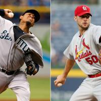 Photo - This combination made from file photos shows Seattle Mariners starting pitcher Felix Hernandez, left, and St. Louis Cardinals starting pitcher Adam Wainwright. Hernandez will start Tuesday night's All-Star game for the American League and Wainwright will open for the National League. (AP Photo)