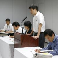 Photo - Tokyo Electric Power Co. spokesman Noriyuki Imaizumi, second right, speaks during a press conference at the TEPCO headquarters in Tokyo Saturday, Aug. 24, 2013, about new findings of the massive quantity of contaminated water leakage from storage tanks at the tsunami-crippled Fukushim Dai-ichi nuclear power plant. (AP Photo/Koji Sasahara)