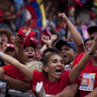 Photo -   Supporters of Venezuela's President Hugo Chavez cheer during a campaign rally in Maracay, Venezuela, Wednesday, Oct. 3, 2012. Chavez is running for re-election against opposition candidate Henrique Capriles in presidential elections on Oct . 7. (AP Photo/Rodrigo Abd)