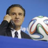 Photo - Italy's coach Cesare Prandelli listens questions during a press conference at Arena Pernambuco stadium in Recife, Brazil, Thursday, June 19, 2014. Italy plays in group D at the soccer World Cup. (AP Photo/Antonio Calanni)