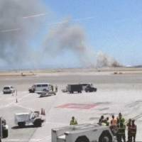 Photo - This photo provided by Wei Yeh shows what a federal aviation official says was an Asiana Airlines flight crashing while landing at San Francisco airport on Saturday, July 6, 2013. It was not immediately known whether there were any injuries. (AP Photo/Wei Yeh)