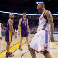 Photo - GAME THREE / L.A. LAKERS: Oklahoma City's Russell Westbrook celebrates after a dunk as Derek Fisher, left, and Pau Gasol of the Lakers watch during the NBA basketball game between the Los Angeles Lakers and the Oklahoma City Thunder in the first round of the NBA playoffs at the Ford Center in Oklahoma City, Thursday, April 22, 2010. Photo by Bryan Terry, The Oklahoman ORG XMIT: KOD