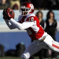 Photo - Houston defensive back Zachary McMillian (10) intercepts a pass against Vanderbilt during the first half of the BBVA Compass Bowl NCAA college football game on Saturday, Jan. 4, 2014, in Birmingham, Ala. (AP Photo/Butch Dill)