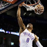 Photo - Oklahoma City's Russell Westbrook (0) dunks the ball during an NBA basketball game between the Oklahoma City Thunder and the Sacramento Kings at Chesapeake Energy Arena in Oklahoma City, Monday, April 15, 2013. Photo by Nate Billings, The Oklahoman