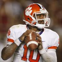Photo -   Clemson quarterback Tajh Boyd looks for a receiver during the second quarter of an NCAA college football game against Florida State on Saturday, Sept. 22, 2012, in Tallahassee, Fla. (AP Photo/Phil Sears)