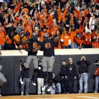 Photo - Oklahoma State's Justin Blackmon (81) and Michael Bowie (61) celebrate a Blackmon touchdown during a college football game between the Oklahoma State University Cowboys (OSU) and the Kansas State University Wildcats (KSU) at Boone Pickens Stadium in Stillwater, Okla., Saturday, Nov. 5, 2011.  Photo by Sarah Phipps, The Oklahoman