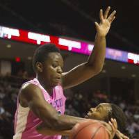 Photo - Texas A&M guard Courtney Walker (33) is fouled by Kentucky center Samarie Walker during the first half of an NCAA college basketball game, Monday, Feb. 18, 2013, in College Station, Texas. (AP Photo/Patric Schneider)