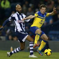 Photo - Everton's Leighton Baines, right, and West Bromwich Albion's Nicolas Anelka battle for the ball during their English Premier League soccer match at The Hawthorns, West Bromwich, England, Monday, Jan. 20, 2014. (AP Photo/PA, David Davies) UNITED KINGDOM OUT