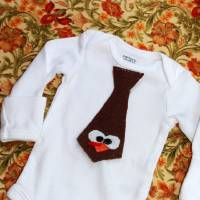 Photo - Blogger Tiff Praha of lovesweatbeers.com recently had a baby, Ethan, and made this cute onesie for him with some leftover pieces of felt from another project. See her blog for instructions.