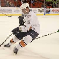 Photo - Dylan Yeo of the Oklahoma City Barons skates past David McIntyre of the Houston Aeros during a hockey game at the Cox Convention Center in Oklahoma City, Friday, April 13, 2012. Photo by Bryan Terry, The Oklahoman