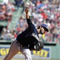 Photo - Milwaukee Brewers' Yovani Gallardo delivers a pitch against the Boston Red Sox in the first inning of a baseball game Sunday, April 6, 2014, in Boston. (AP Photo/Steven Senne)