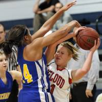 Photo - Piedmont's Breanu Reid (14) puts pressure on McLoud's Erica Hostetter (11) during a basketball tournament at the Kingfisher High School gym on Thursday, Jan. 24, 2013, in Kingfisher, Okla.  Photo by Chris Landsberger, The Oklahoman