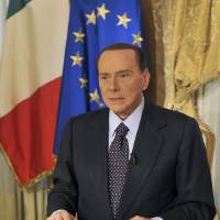 Photo -   In this photo released by the Berlusconi press office Thursday, Oct. 25, 2012, former Italian premier Silvio Berlusconi tapes a video message where he announces he will not run for a fourth term as premier in spring elections. Berlusconi has until now been coy about his intentions. But the three-time former premier posted a statement on his movement's website yesterday, under the headline: