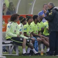 Photo - Brazil's coach Luiz Felipe Scolari, right, speaks with players, from left, David Luiz, Neymar, Thiago Silva, Hulk, and Fernandinho, during a training session at the Granja Comary training center in Teresopolis, Brazil, Tuesday, July 1, 2014. Brazil will face Colombia on July 4 in the quarter-final of the 2014 soccer World Cup. (AP Photo/Andre Penner)