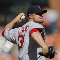 Photo - Boston Red Sox starting pitcher Jon Lester throws to the Baltimore Orioles in the first inning of an opening day baseball game, Monday, March 31, 2014, in Baltimore. (AP Photo/Patrick Semansky)