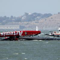 Photo - The overturned Artemis Racing AC72 catamaran, an America's Cup entry from Sweden, is towed past Treasure Island after the boat capsized during training in San Francisco Bay on Thursday, May 9, 2013, in San Francisco, Calif. (AP Photo/San Jose Mercury News, Karl Mondon)  MAGS OUT; NO SALES, MADATORY CREDIT BAY AREA NEWSPAPERS