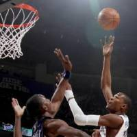 Photo - Oklahoma City's  Kevin  Durant puts up a shot over Hasheem Thabeet of Memphis during the NBA basketball game between the Oklahoma City Thunder and the Memphis Grizzlies at the Ford Center in Oklahoma City on Wednesday, April 14, 2010. Photo by Bryan Terry