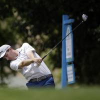 Photo - Brendon Todd hits off the first tee during the third round of the Byron Nelson Championship golf tournament, Saturday, May 17, 2014, in Irving, Texas. (AP Photo/Tony Gutierrez)