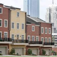 Photo - A proposed new Oklahoma City ordinance would mean downtown residents could only put items designed for outdoor use on areas of their balconies visible from a public street. The balconies shown here are on town homes downtown.  PAUL HELLSTERN - The Oklahoman
