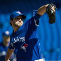Photo -   Toronto Blue Jays starting pitcher Brandon Morrow works against the Boston Red Sox during the first inning of a baseball game in Toronto on Sunday, Sept. 16, 2012. (AP Photo/The Canadian Press, Nathan Denette)