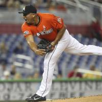 Photo -   Miami Marlins starter Carlos Zambrano pitches to the New York Mets during the third inning of a baseball game in Miami, Sunday, May 13, 2012. (AP Photo/J Pat Carter)