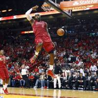 Photo - Miami Heat's LeBron James (6) dunks as Oklahoma City Thunder's Russell Westbrook (0) and Heat's Mario Chalmers (15) watch during the first half of an NBA basketball game, Tuesday, Dec. 25, 2012, in Miami. (AP Photo/J Pat Carter) ORG XMIT: FLJC101