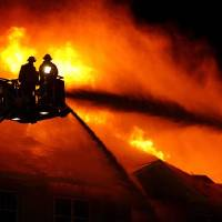 Photo -  Firefighters battle a four story apartment fire at the Enclave luxury apartments near the intersection of Covell Road and Kelley on Monday, Oct. 19, 2009, in Edmond, Okla. Photo by Chris Landsberger, The Oklahoman
