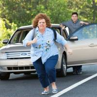 Photo - Jason Bateman, background, and Melissa McCarthy in a scene from