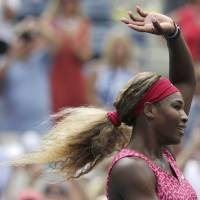 Photo - Serena Williams, of the United States, reacts after defeating Kaia Kanepi, of Estonia, during the fourth round of the 2014 U.S. Open tennis tournament, Monday, Sept. 1, 2014, in New York. (AP Photo/Charles Krupa)