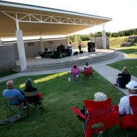 Photo - Visitors at the Mitch Park Amphitheater watch Straight Shooter perform during the opening night of the city's Fall Concert Series. PHOTO BY JOHN CLANTON, THE OKLAHOMAN  JOHN CLANTON - THE OKLAHOMAN