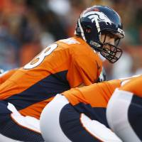 Photo -   Denver Broncos quarterback Peyton Manning lines up against the Pittsburgh Steelers during the first quarter of an NFL football game, Sunday, Sept. 9, 2012, in Denver. (AP Photo/David Zalubowski)