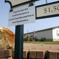 Photo - A sign placed at the entrance to a mobile home park by manager John Bowman sums up the park's progress on Tuesday, Sept. 1, 2009.  Only one double-wide mobile home remains much as it was left by a deadly tornado that struck this Lone Grove, Okla. mobile home park.  Other homes in the park have been demolished, removed and replaced.  Photo by Steve Sisney, The Oklahoman ORG XMIT: KOD