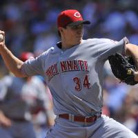 Photo - Cincinnati Reds starter Homer Bailey delivers a pitch during the first inning of a baseball game against the Chicago Cubs in Chicago, Sunday, April 20, 2014. (AP Photo/Paul Beaty)