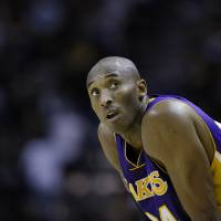 Photo - Los Angeles Lakers' Kobe Bryant carches his breath during the fourth quarter of an NBA basketball game against the San Antonio Spurs, Wednesday, Jan. 9, 2013, in San Antonio. San Antonio won 108-105. (AP Photo/Eric Gay)