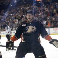 Photo - Anaheim Ducks' Corey Perry celebrates a goal by teammate Matt Beleskey during the second period of an NHL hockey game against the San Jose Sharks on Wednesday, April 9, 2014, in Anaheim, Calif. (AP Photo/Jae C. Hong)