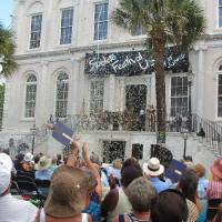 Photo - FILE - In this Friday, May 25, 2012 photo, confetti rains down on the crowd during the opening ceremonies of the Spoleto Festival USA in Charleston, S.C. On Sunday, Dec. 9, 2012, the festival announced its lineup for the upcoming 2013 season. (AP Photo/Bruce Smith)